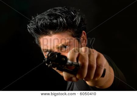 One Eye Above A Gun