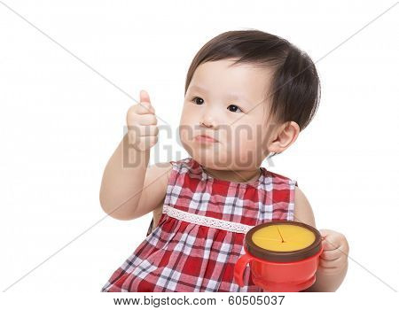 Asian baby girl with snack box and thumb up