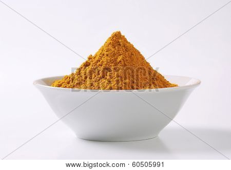 side view of bowl with curry powder