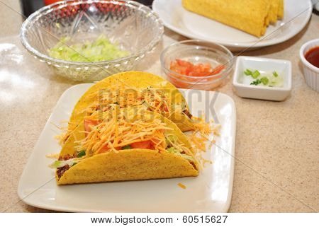 Two Cheesy Tacos with Fresh Ingredients