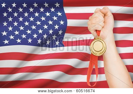 Medal In Hand With Flag On Background - United States Of America