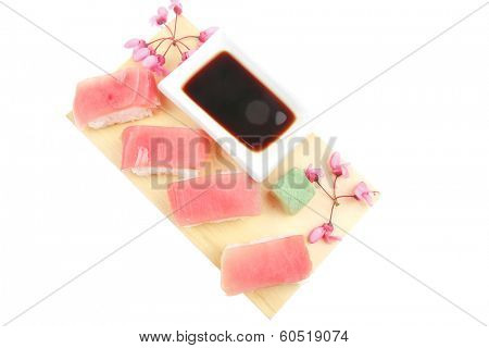 Japanese traditional Cuisine - Set of Nigiri sushi topped with raw Tuna (maguro) . Isolated over white background