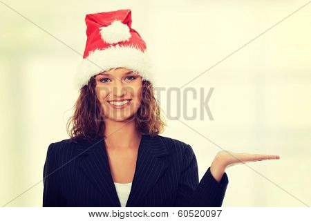 Beautiful business girl wearing santa's cap
