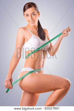 woman athlete with measuring tape