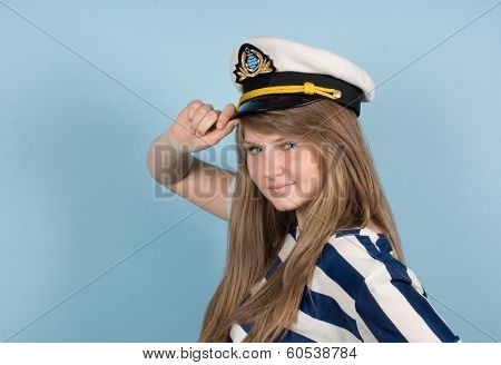 Pretty woman wearing sea Captain's cap and sailor shirt