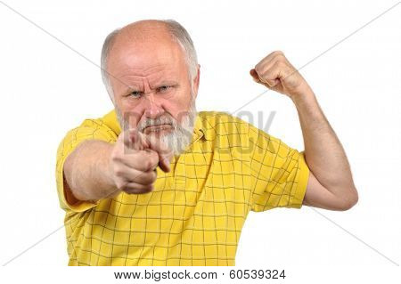menacing senior bald man in yellow shirt
