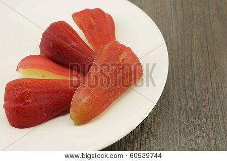 Rose Apple With Dark Brown Wood Background