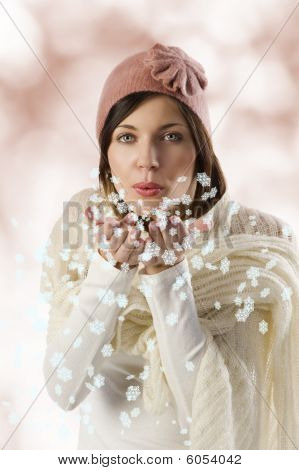 Sweet Girl Blowing On Snow Flakes