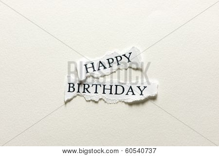 A scrap of paper with the words happy birthday