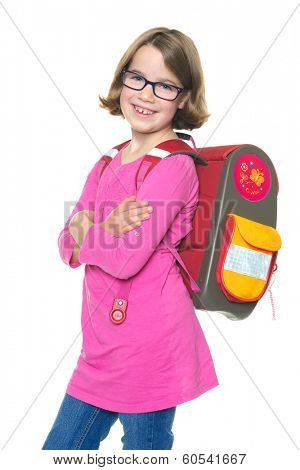 Smiling young girl with schoolbag in front of white background