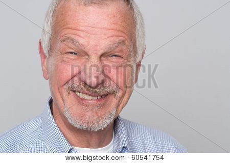 Senior man in front of grey background