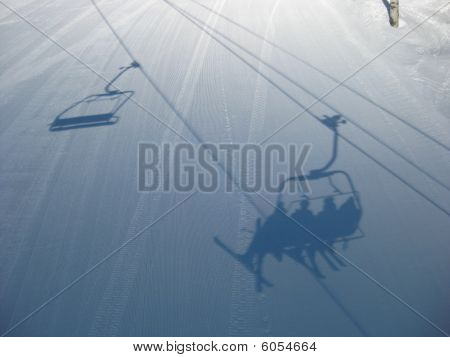 Skiers shadow on a freshly groomed slope