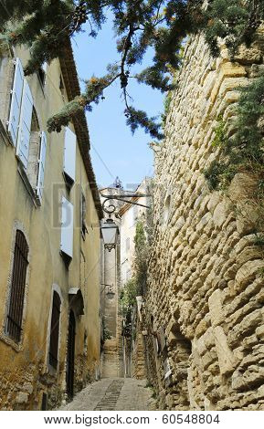 Narrow street toward Gordes Castle in the Luberon, France