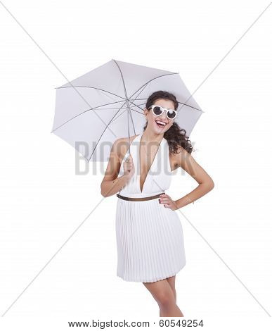 Happy woman wearing sunglasses and umbrella in hand