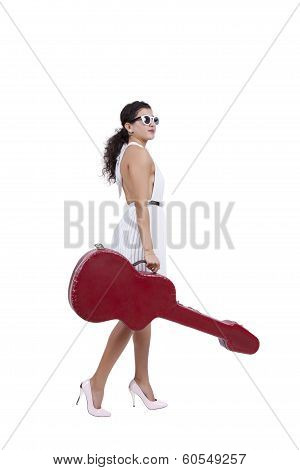 Young woman posing with guitar