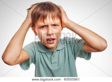 Boy child man upset angry shout produces evil face portrait isol