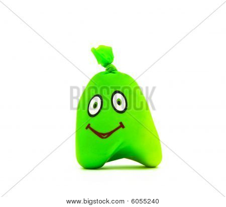 toy In The Form Of Green Smile On A White Background