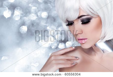 Fashion Blond Girl. Beauty Portrait Woman. Holiday Make-up. Snow Queen High Fashion Portrait Over Bl