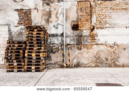 Heap Of Pallets The Brick Before A Wall