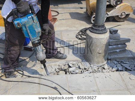 Worker Of Road Construction Drilling Cement Ground  Use For Infra Structure Construction And Human W