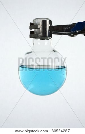 Round-bottomed Glass Beaker In A Metal Clamp
