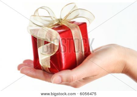 Red Gift Box In Woman's Hand