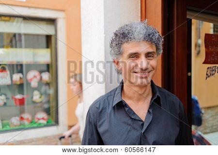 VENICE, ITALY - JUNE 12, 2011: close-up portrait of waiter. Venice is a city in northeastern Italy sited on a group of 118 small islands separated by canals and linked by bridges