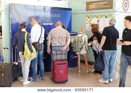 BARCELONA, SPAIN - JUNE 12, 2011: express check-in kiosks of Spanair in Barcelona International Airport on June 12, 2011 in Spain. Spanair S.A. was a Spanish airline. The last passenger flight was JK1326