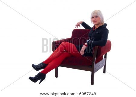 Fashion Glamour Girl Sitting In Soft Chair. Isolated On White Background.