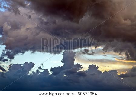Dark Clouds At Sunset