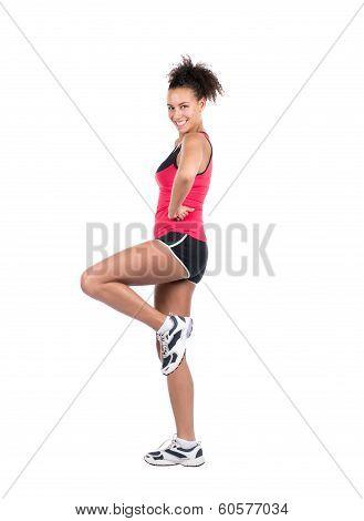 Young Sportswoman Rises Her Leg