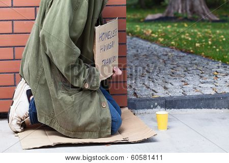 Beggar Asking For Money And For Food
