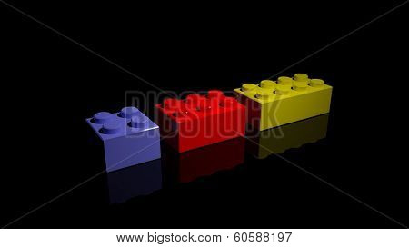 Three plastic blocks isolated on black background