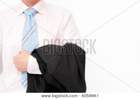 Businessman holding jacket