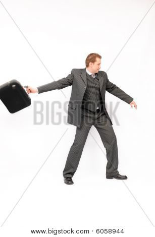 Businessman throwing a briefcase