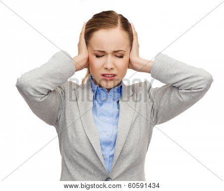 busienss, emotions and office concept - stressed businesswoman with covered ears and closed eyes