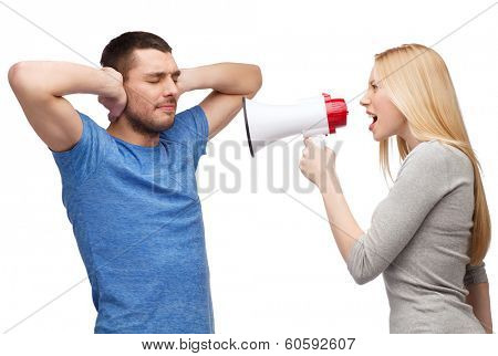 couple, family and relationship problems concept - girlfriend screaming though megaphone at his boyfriend