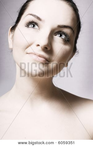 Beautiful Young Womans Face Looking Up
