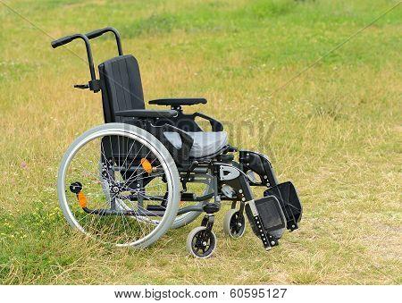 Empty Wheelchair On Meadow