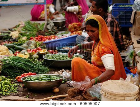 Vegetable Seller In The Bazaar In India