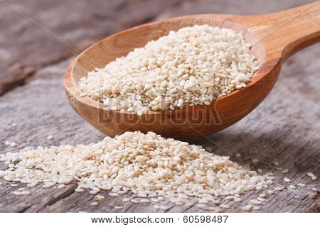 Sesame Seeds In A Wooden Spoon Closeup