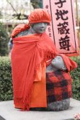 Dressed Statue Of Mother With Children In Tokyo