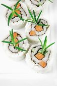 Japanese Cuisine - California Roll made of Fresh raw Salmon, Cream Cheese and Avocado inside. Served