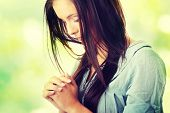 picture of kneeling  - Closeup portrait of a young caucasian woman praying - JPG