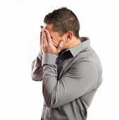 Men Covering His Eyes Over White Background