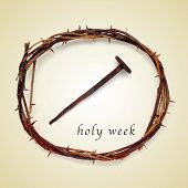 stock photo of golgotha  - the Jesus Christ crown of thorns and a nail and the sentence holy week on a beige background - JPG