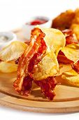 stock photo of tar  - Potato Chips and Bacon Chips with Tar - JPG