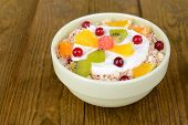 stock photo of lenten  - Delicious oatmeal with fruit in bowl on table close - JPG