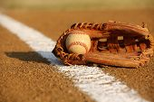 image of infield  - Used Baseball in a Glove in the Infield - JPG