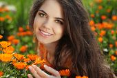 stock photo of marigold  - Happy smiling girl - JPG